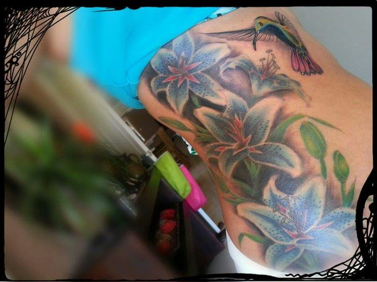 Blue Lilies and hummingbird tattoo, body art, women's side tattoos.