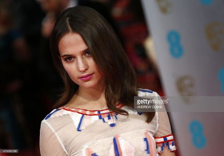 Swedish actress Alicia Vikander arrives on the red carpet for the BAFTA British Academy Film Awards at the Royal Opera House in London on February 16, 2014.