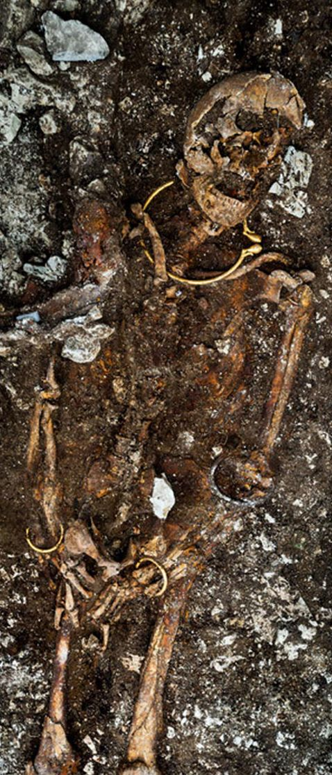 The tomb of a decorated skeleton, dating back some 2,500 years, was discovered in an industrial area of Lavau, a village near Troyes, south east of Paris in early 2015. This Celtic's high stature in society is clear from a stunning gold necklace, bracelets, and finely worked amber beads adorning the skeleton, as well as precious grave goods retrieved. The burial mound, called a tumulus, covers nearly 7,655 square yards.