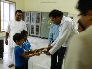 Mr. Bajaj welcomed by schools children with gifts..