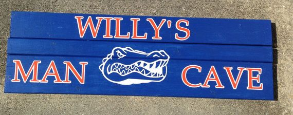 Wooden Florida Gators Man Cave sign. Sign is hand painted, with white and orange lettering and a white Gator Head. The sign is made from 3