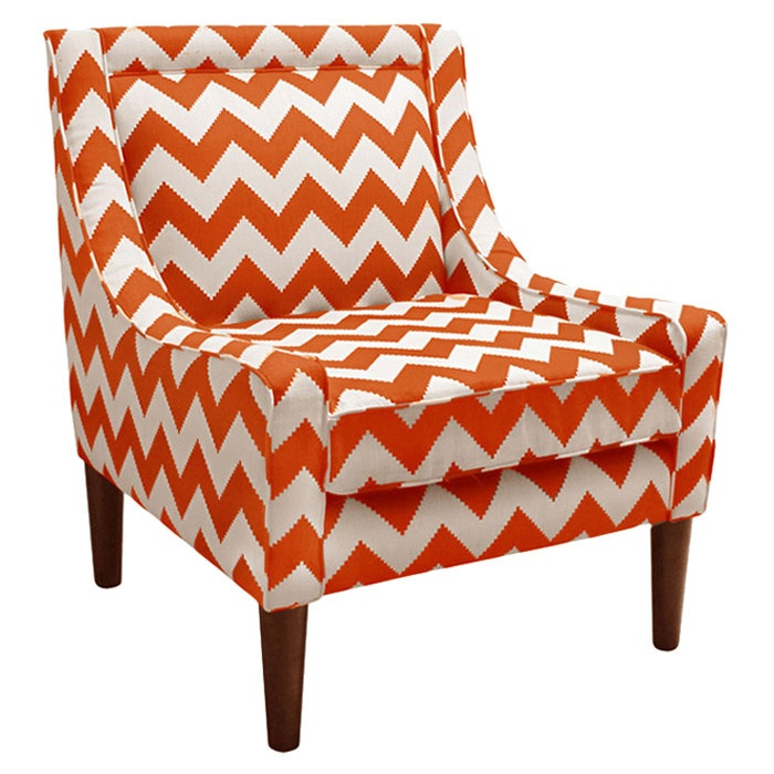 Chevron accent Chair in burnt orange and white.
