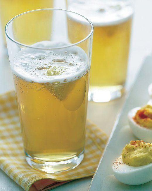 Lemon Shandies 1/2 cup sugar 3/4 cup fresh lemon juice (from about 4 lemons), plus wedges, for serving (optional) 8 mild pilsner beers (12 ounces each)