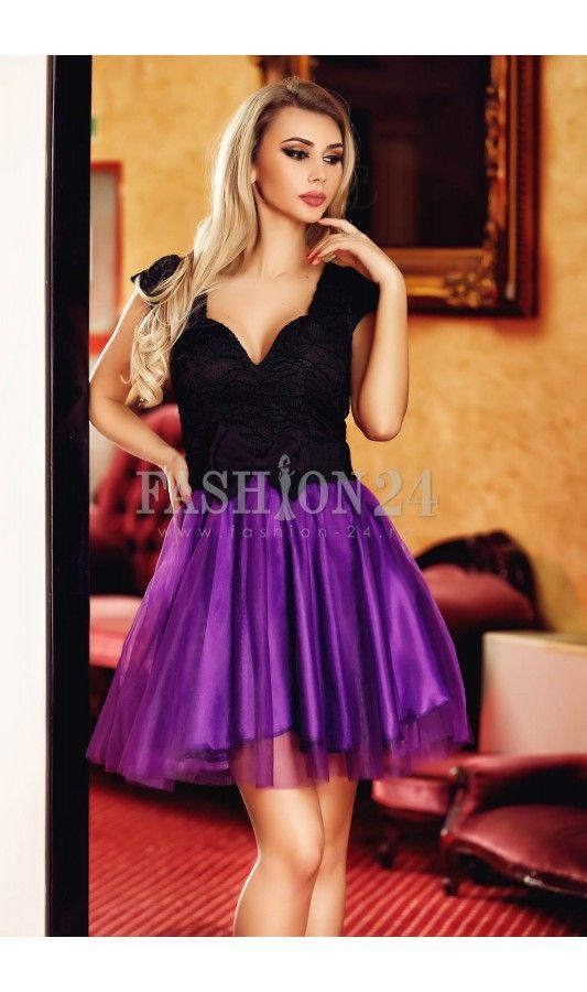Rochie Black Surprise -  Rochia eleganta Black Surprise este un model ce te va face cu siguranta remarcata! Este o rochie deosebita, in nuante de negru si mov, lucrata din tul si dantela, cu maneci scurte, decolteu in U si inchidere prin fermoar lateral, fabricata in Romania.  culoare: Negru si Mov   rochie eleganta de seara   din tul si dantela   cu manecile scurte   bustul buretat   inchidere prin fermoar lateral   lungimea rochiei: 87 centimetri  Material: Poliester PRODUS IN ROMANIA…