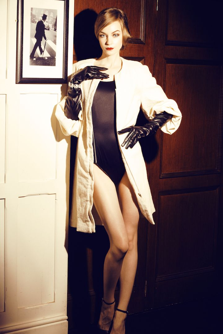 Attached glove on off white coat to cover the sexiness of black body suit.