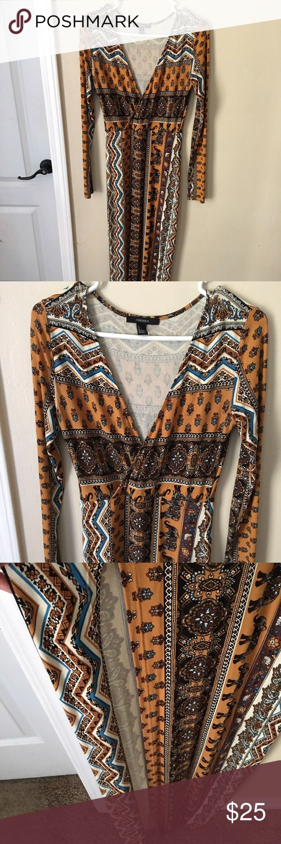 Tribal maxi dress Selling this long sleeve maxi dress form fitting high slit on the right side deep v chest area. Can be dressed up or down. Give me your best offer Forever 21 Dresses Maxi