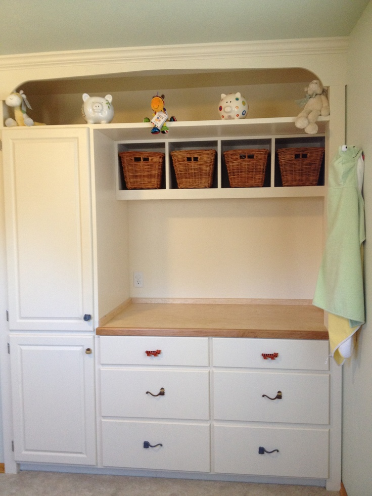 I tore out the closet and built in a changing table with drawers and cabinet for the nursery. Copied this idea from This Old House