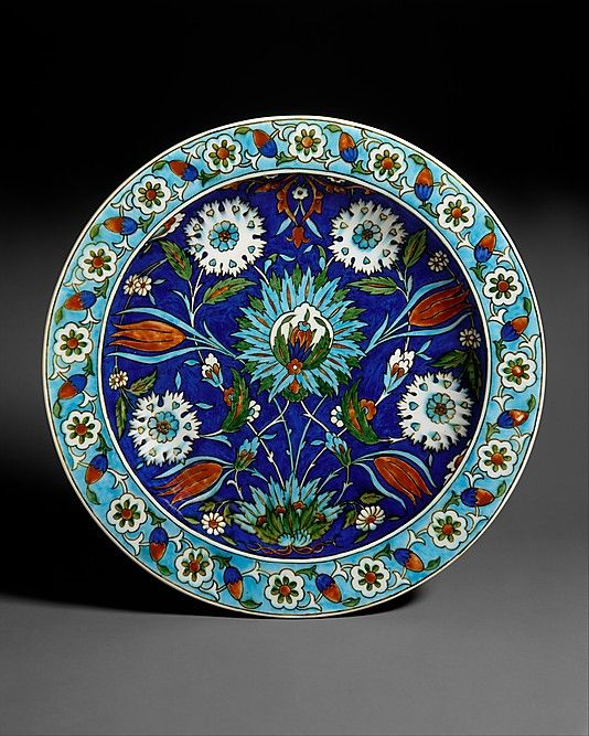 Dish | Joseph-Théodore Deck (French, 1823-1891) | Paris, France, circa 1870 | Earthenware with underglaze and enamel polychrome decoration ('Persian' faience) | The decoration of this dish is derived from Turkish ceramics made in the town of Iznik between 15th-17th centuries. Although Deck borrowed Iznik colors and motifs, he did not make exact replicas of their designs. Instead he loosely adapted motifs, creating designs of his own invention | The Metropolitan Museum of Art, New York