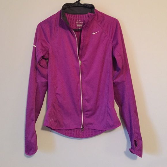 Nike dri fit waterproof jacket Nike waterproof jacket, like new with no flaws, dri fit, inside is cottony soft and warm, outside is waterproof, has thumb holes, has a back pocket, reflective detailing, perfect for runners, in excellent condition and looks a lot better on! Bundle to save ❤️ size womens small and fits true to size Nike Jackets & Coats