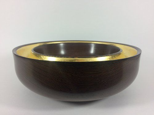 By Moth and Mirror, wenge with gold leaf.