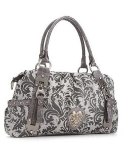 Kathy Van Zeeland purses are my favorite!!!!  and, I LOVE this print!! :)