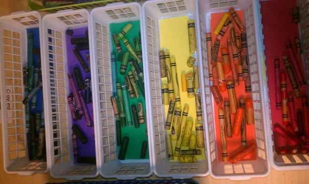 Keep crayons organized by placing colored construction paper in the bottom of the bins. | 29 Clever Organization Hacks For Elementary School Teachers