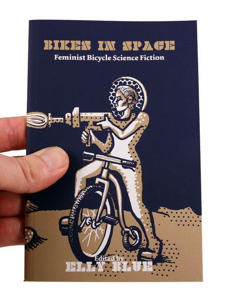 Bikes in Space shark zine cover  A reader of science fiction since she was a child, Elly Blue elected to make this issue of Taking the Lane into a powerful tribute to feminist sci-fi about bicycles. It gravitates away from the unfortunately-traditional macho heroes, hurtling through space with giant guns, ready to protect and/or tame their scantily clad space babe.
