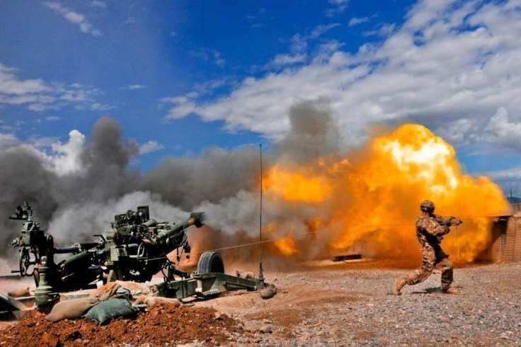 Private first class Erik Park from San Mateo, California, fires his M-777 155mm howitzer.