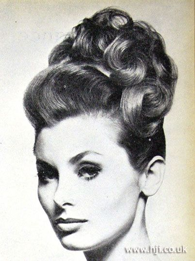1962 Updo Curls Hairstyle. This is just so amazing. Put a tiara or decorative headband/ribbon on the front and flowers on the underside.