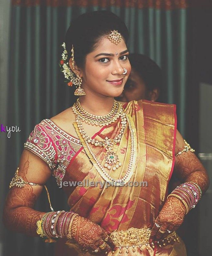Love this bride's jewellery...beautiful papadi billa, matching choker, pearl and ruby haaram, kasula mala, kundan vanki, vaddanam...