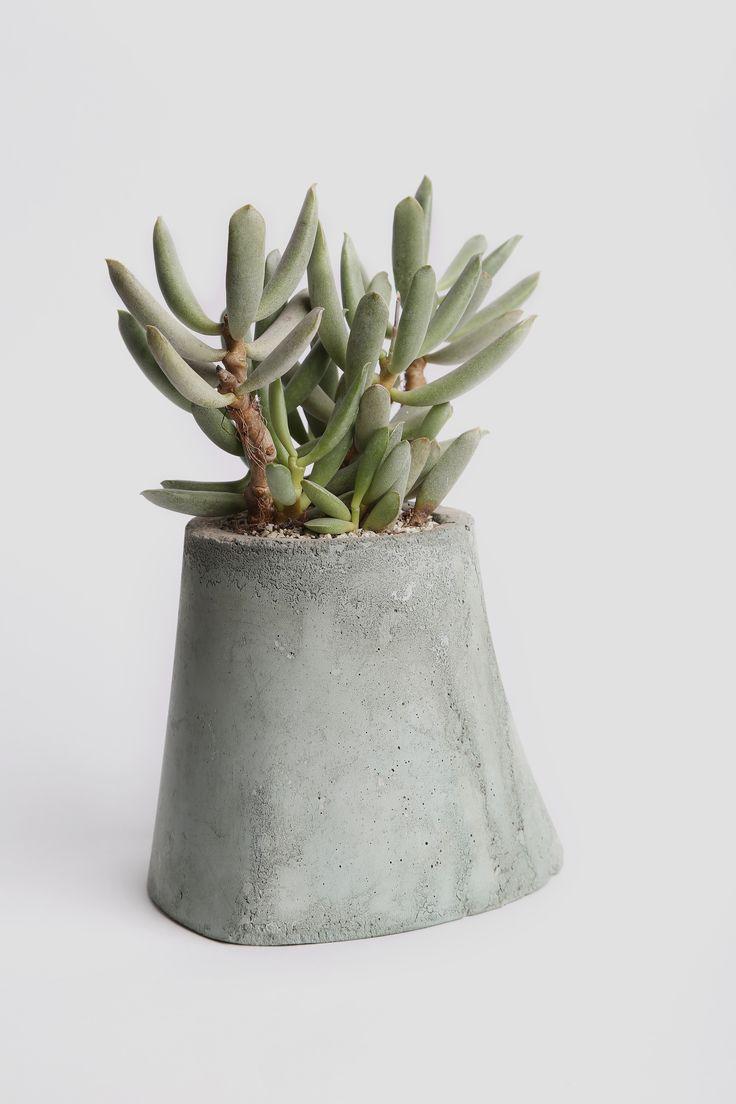 Concrete pot by IAM Architecture Studio