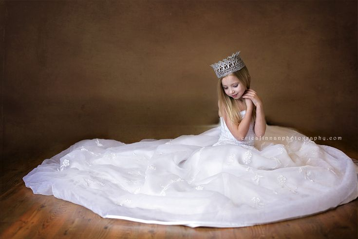 5 year old in mothers wedding dress in galion ohio photography studio ~ do this with Mary?! She loves my dress and wants to wear it! But she can't grow up that quickly :P