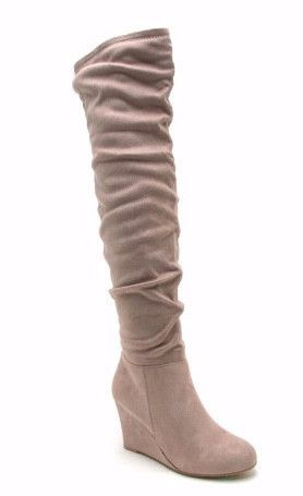 Get the look of this fall with our over the knee suede boots in Taupe. Do you walk a lot for work or going out down town?! No worries, These boots have a wedge heel making it super comfortable to walk