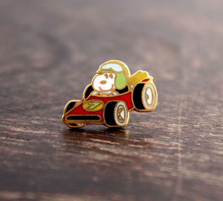 Adorable tiny vintage Snoopy Indy race car driver pin - enamel cloisonne. Official 1970's Peanuts merchandise from United Pictures by Aviva.
