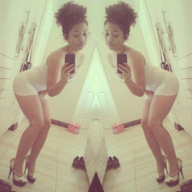 White spaghetti dress & heels. Curly updo :)