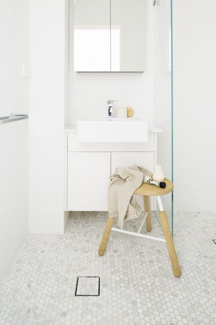Kirribilli studio apartment by Kate Connors Interiors. Bathroom features Carrara marble hex tile. Photographed by Craig Wall.