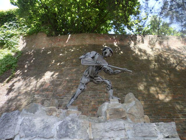 Fiorenzuola di Focara sculpture above war memorial