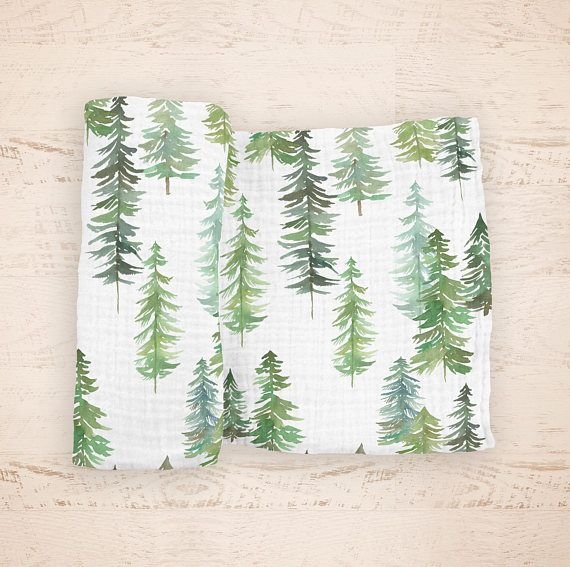 Our Woodland Pine Swaddle Blanket Features Watercolor Pine