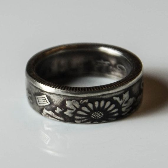 Handcrafted #CoinRing from #TheRingTree made from a #Japanese 50 Yen coin.