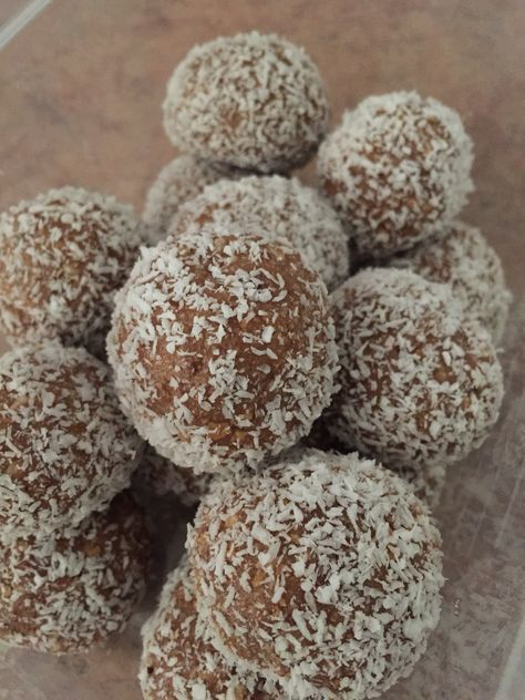 milo balls 250grams milk arrowroot biscuits (crushed) 395grams sweetened condensed milk 4 tablespoons milo desiccated coconut for rolling