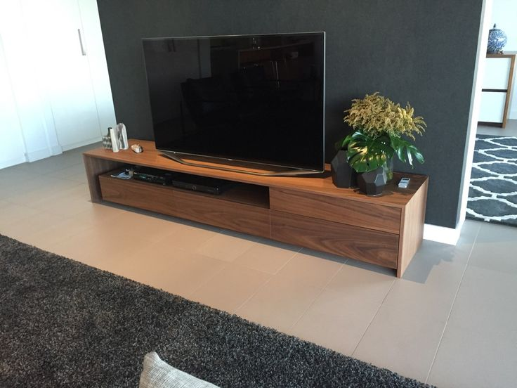 This piece was custom made and designed by Sally Timms. It was manufactured in American Black Walnut Veneer, 2.6m long, with 4 draws and an opening for audio equipment.