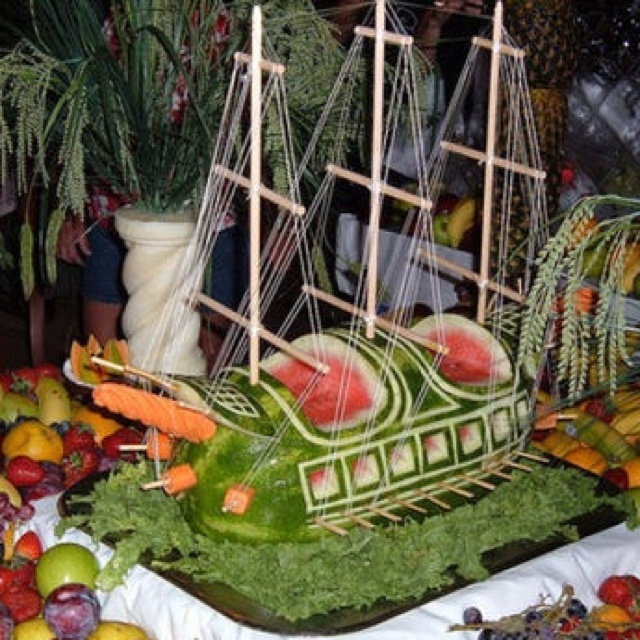 Pirate ship watermelon carving with masts, sails, and fruit!