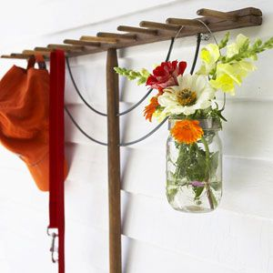An old wooden rake on the wall is perfect for hanging things