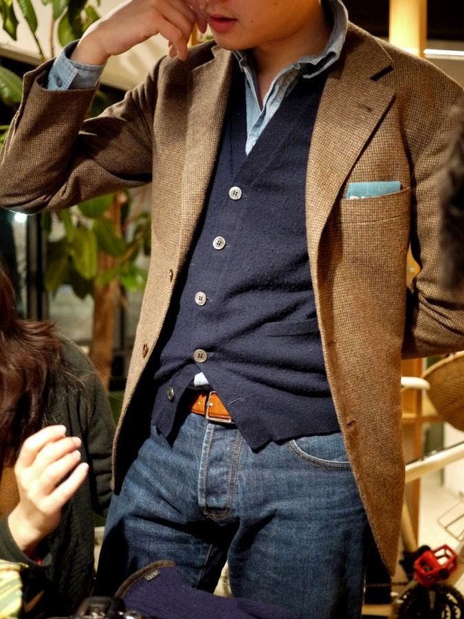 Shop this look for $486:  http://lookastic.com/men/looks/jacket-and-jeans-and-longsleeve-shirt-and-pocket-square-and-cardigan-and-belt/1539  — Brown Tweed Jacket  — Navy Jeans  — Light Blue Chambray Longsleeve Shirt  — Light Blue Pocket Square  — Navy Cardigan  — Tobacco Leather Belt