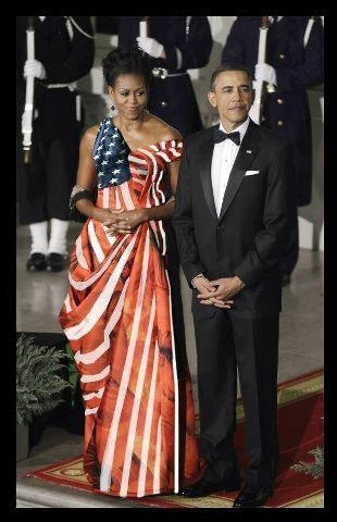 President Barack Obama, the 44th President, and wife,Michelle, wearing a gorgeous dress.