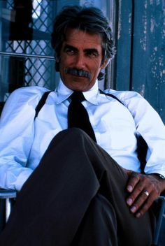 Sam Elliott - that twinkle in his eyes...the tasche...and, the huskiest, sexiest voice that I would like to hear good nite from...........