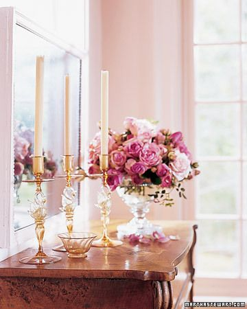 Pink    Amber-and-gold Venetian glass candlesticks stand on the Victorian flip-top desk.