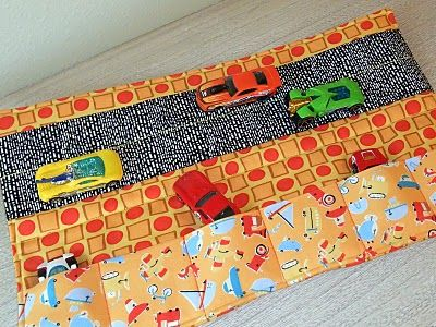 Toy Car Caddy Tutorial.. would be great with bigger pockets with elastic to hold the cars in