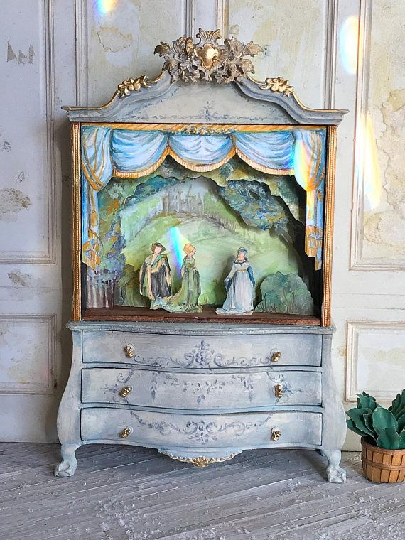 Dollhouse Toy Theatre Cabinet 1:12 Dollhouse Scale, adorable for a child's room! Enjoy RUSHWORLD boards, LULU'S FUNHOUSE, LUXURY HOME DECOR AND PRACTICAL TREASURES and UNPREDICTABLE WOMEN HAUTE COUTURE. Follow RUSHWORLD! We're on the hunt for everything you'll love!