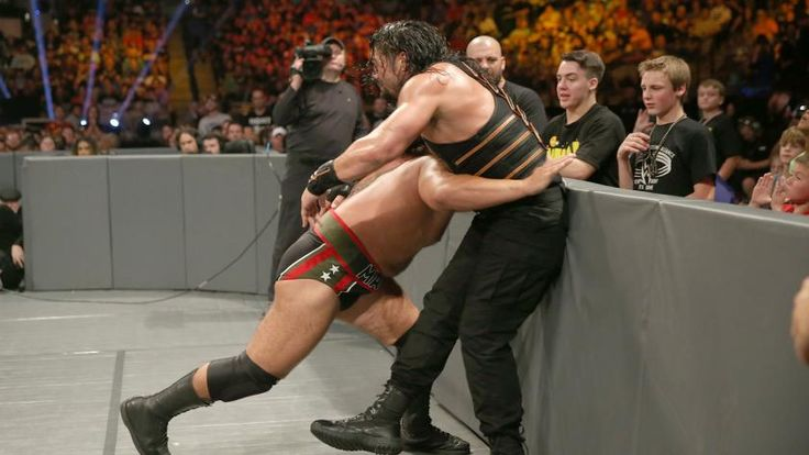 Roman Reigns challenges Rusev for the United States Championship in a heated confrontation at WWE Clash of Champions.