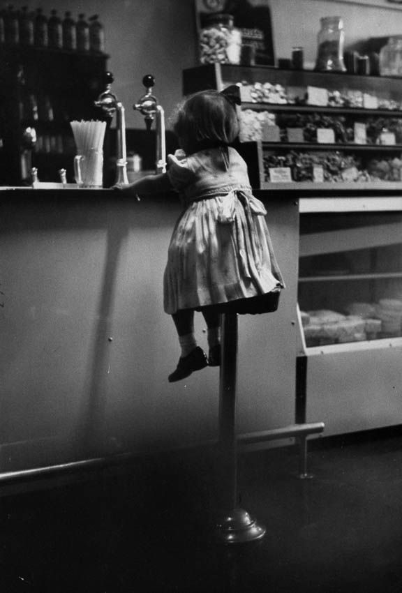 1950s little girl at the malt shop counter