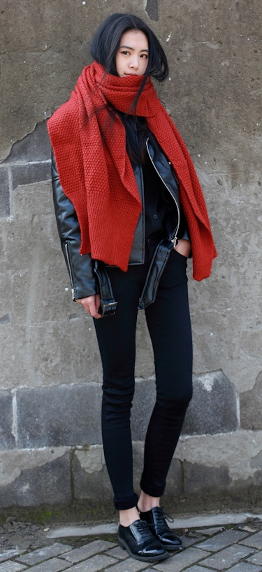 An oversized scarf with a leather jacket, skinny jeans and oxfords.