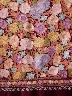 kashmiri embroidery :   Kashmiri embroidery(also Kashida), is as colorful and as beautiful as Kashmir itself. Embroiderers often draw inspiration from nature. Birds, blossoms and flowers, creepers, chinar leaves, ghobi, mangoes, notus, and trees are the most common themes. The entire pattern is uses one or two embroidery stitches.