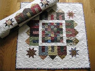 Schnibbles-love the block center and using the houses as the border...<3 the white to make it all pop