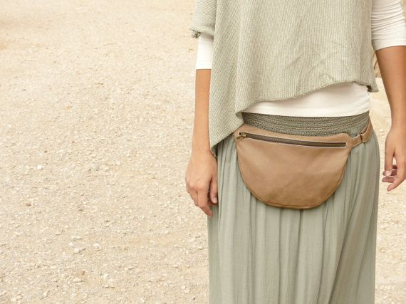 """OMG OMG are fanny packs (""""waist bags""""?) coming back?!? I HATE carrying my purse on my shoulder! This would be cute if it were carried on the hip, rectangular (longer than it is wide) and fastened around the waist with something that looked like a belt. Perforated leather would be cute. Maybe I should just make one!"""