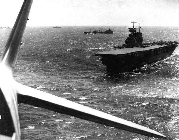 USS Yorktown (CV-5) operating in the vicinity of the Coral Sea, April 1942. Photographed from a TBD-1 torpedo plane that has just taken off from her deck. Other TBD and SBD aircraft are also ready to be launched. #WWII