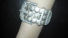 I love this bracelet! I just got it and it goes with EVERYTHING!!!!First Design