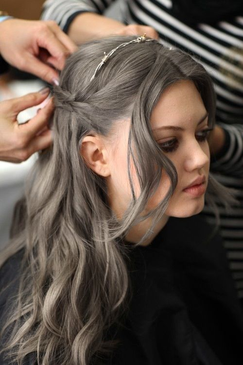 "I guess they want this poor girl to have Ash Gray at a young age! Hair: a complicated mixture of gray & real ash brown tones. Skin: just enough warmth in her make up to allow the gray to dominate this odd mix of Ash Gray and Ash Medium Brown. In case you aren't aware, ash colors are based on gray anyway, that is what gives them that ""ashy"" look. BUT here is the odd scene of a gorgeous young model, w/gray dominating the ash brown & it works for her."