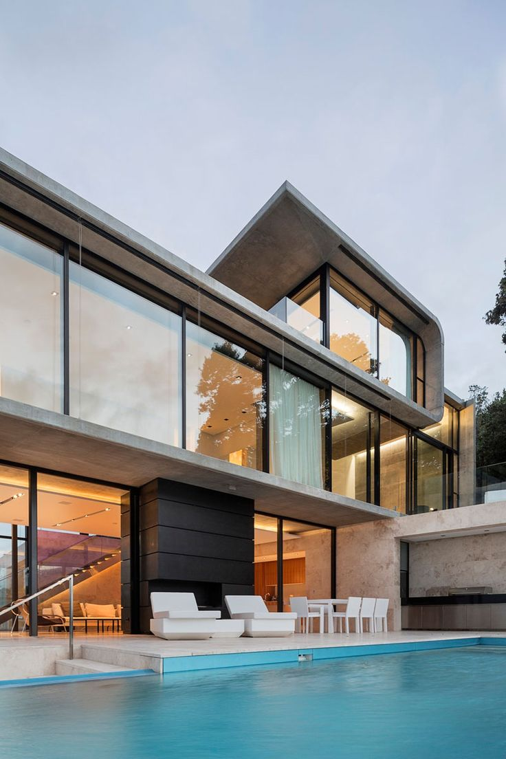Archimedia in collaboration with their client designed this home that sits high above a rocky