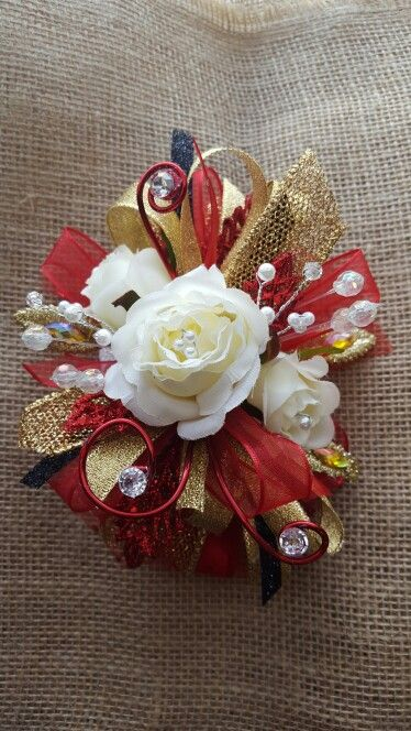 Red and gold prom corsage from www.henhousedesigns.net